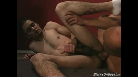 Thin gay white guy sucking off black cocks at a gloryhole
